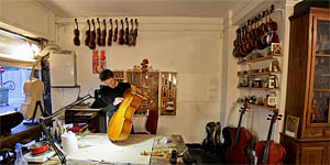 Luthier inside the old town of Valencia
